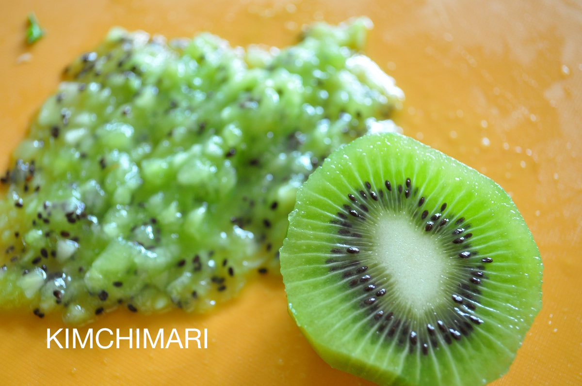 chopped kiwi on cutting board