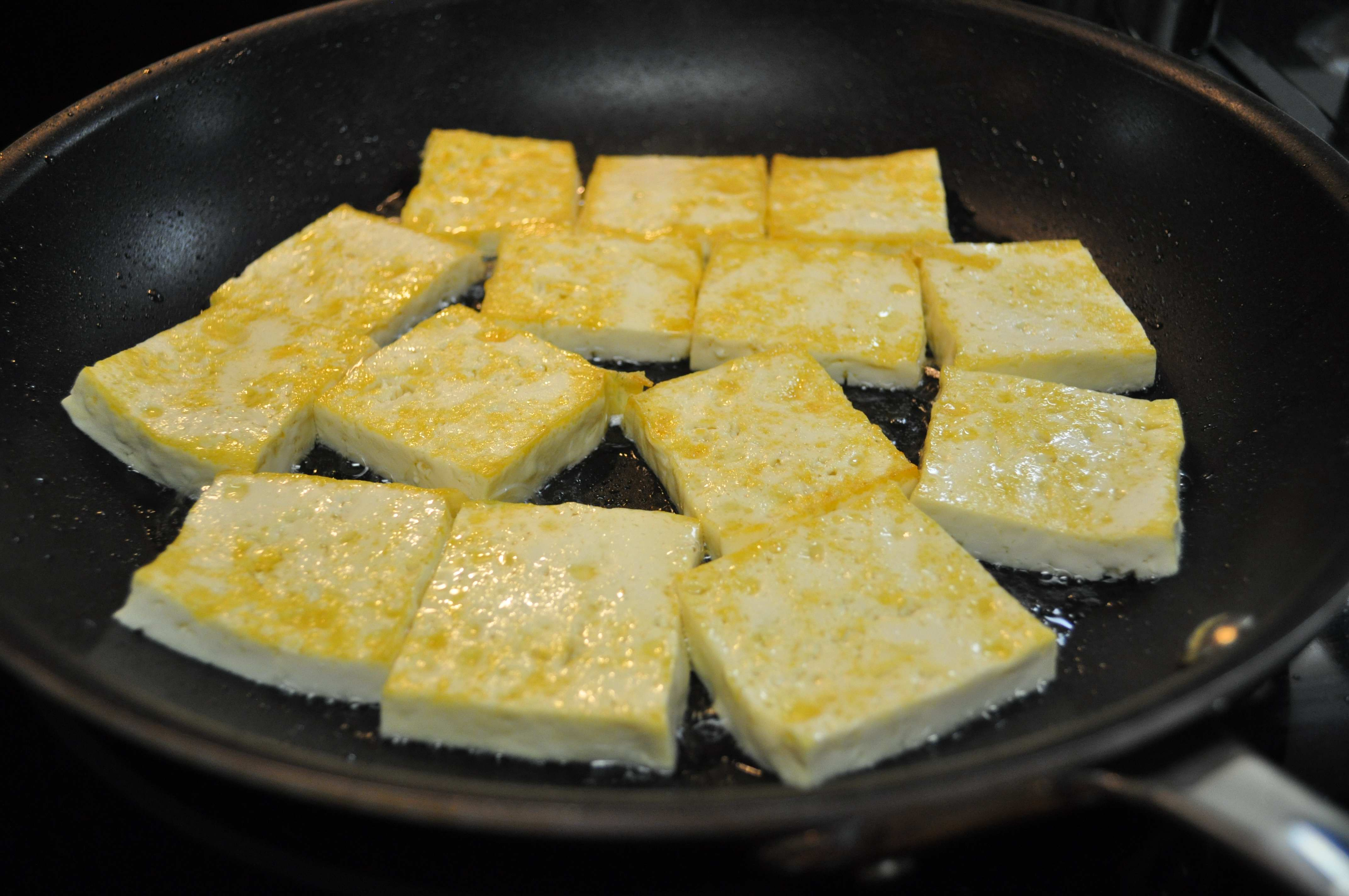 Tofu lightly browned in pan