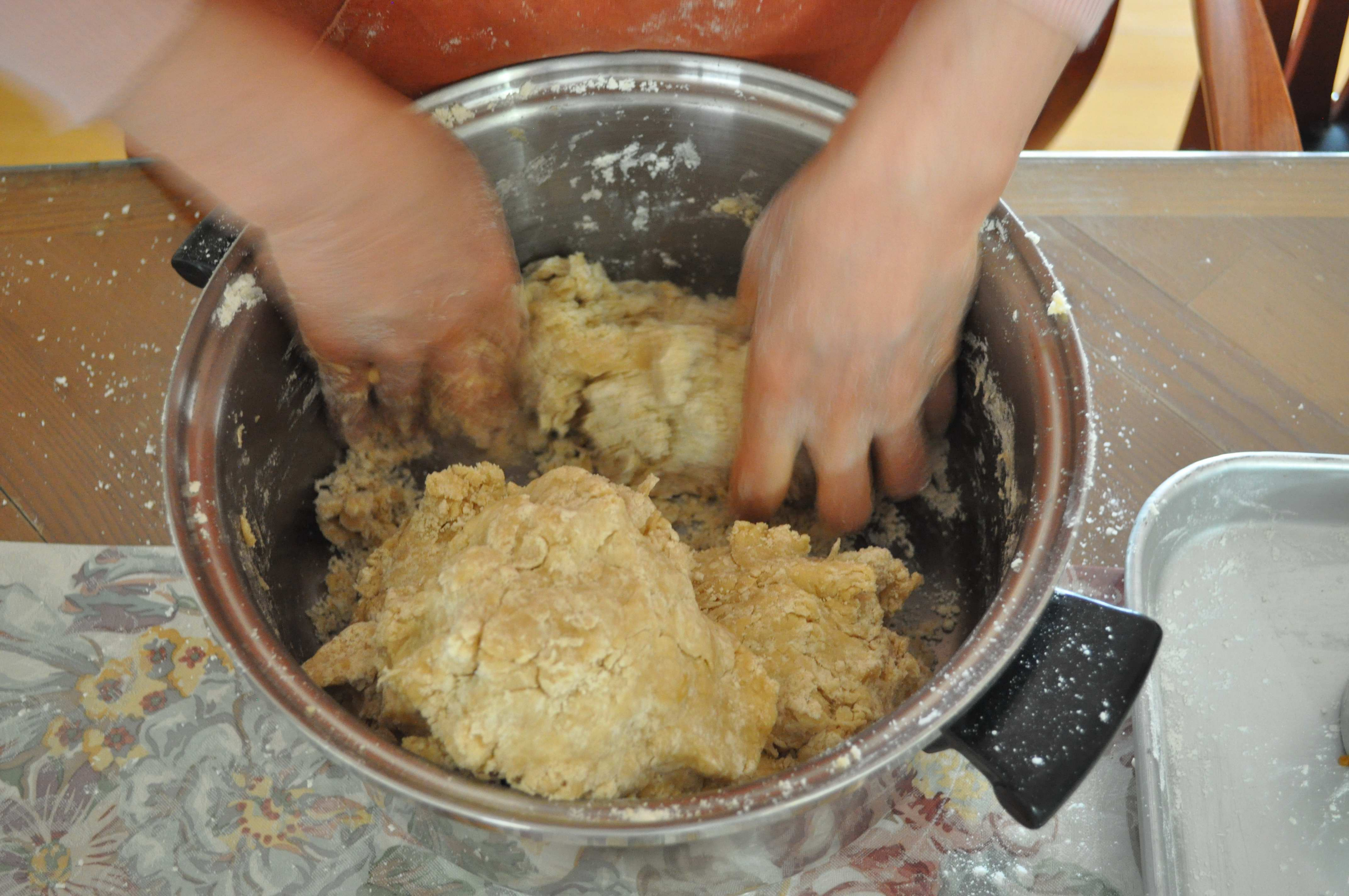 Mixing Yakgwa dough with hands