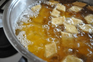 Yakgwa frying in oil - few pieces rising to top