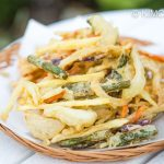 finished vegetable fries piled on paper lined plate