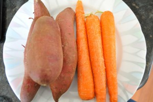 whole sweet potatoes and carrots on plate