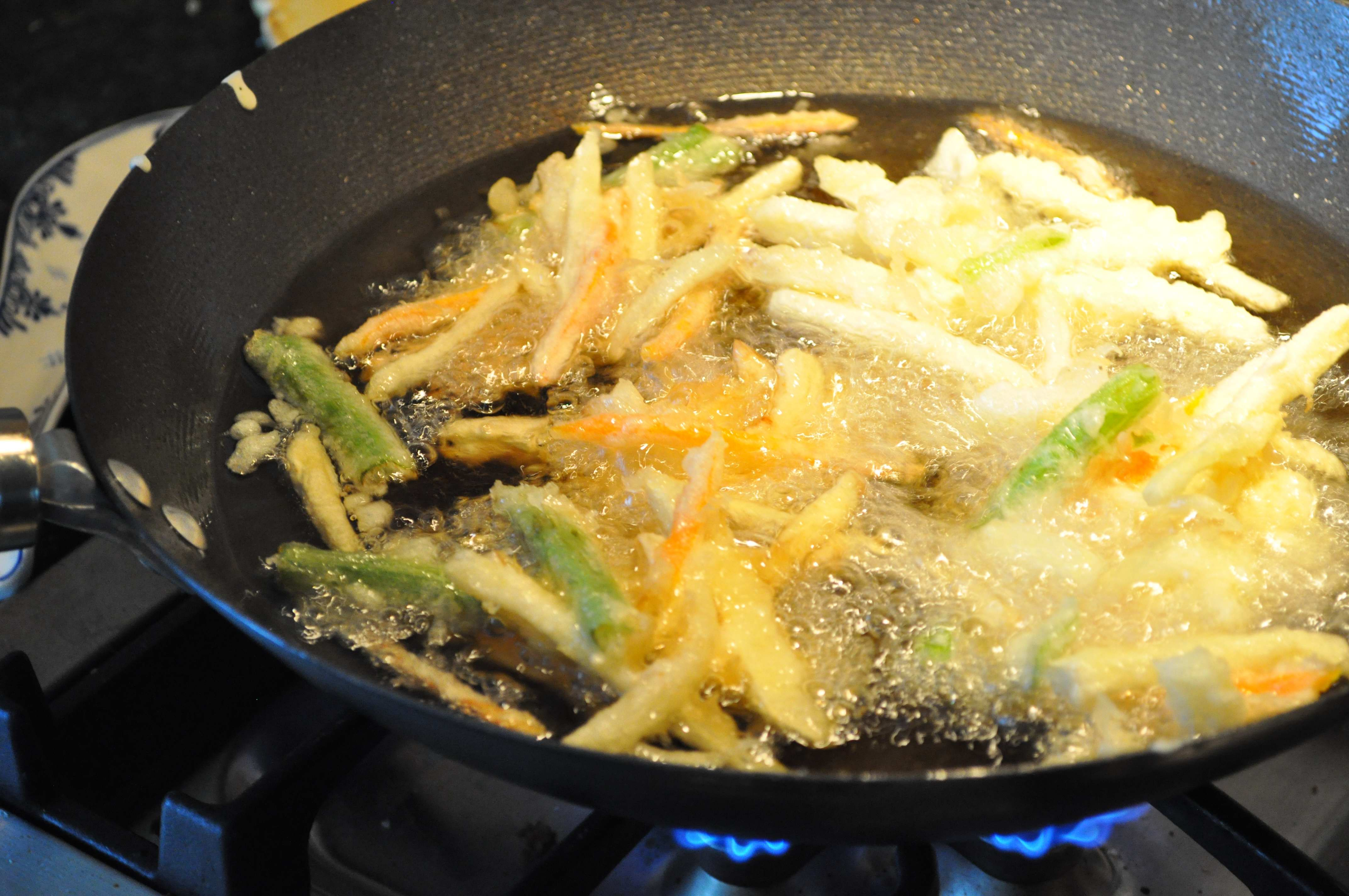 Vegetables frying in oil