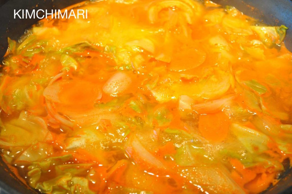 Spicy Rice Cake boiling with veggies