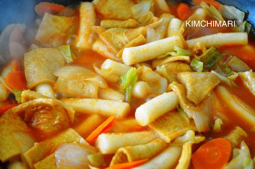 Tteokbokki - Korean spicy rice cake with vegetables, cooking in pan