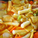 Tteokbokki - Korean spicy rice cake with vegetables, cooking in pan
