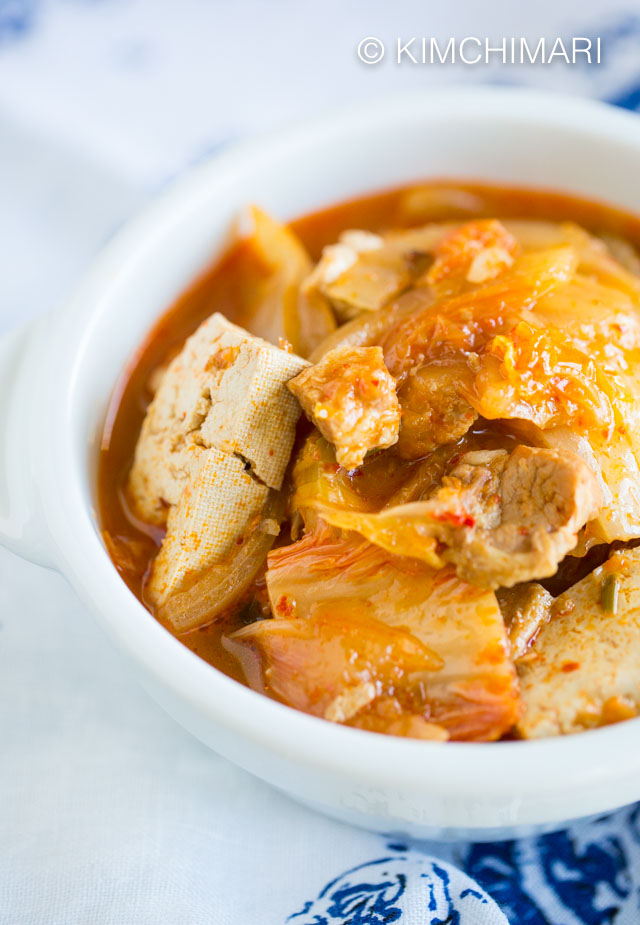 Kimchi Jjigae (Kimchi Stew with Pork Belly) in white bowl