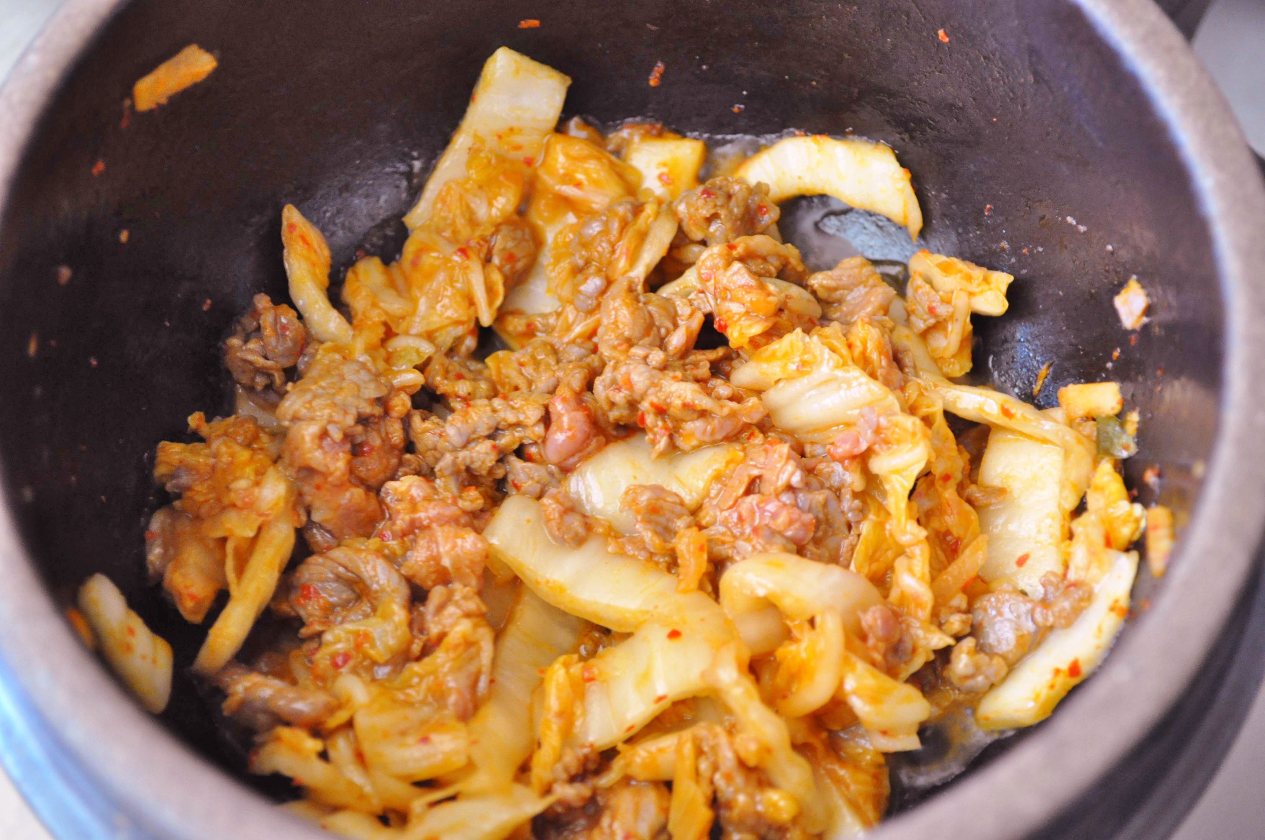 kimchi and beef cooking in hot pot