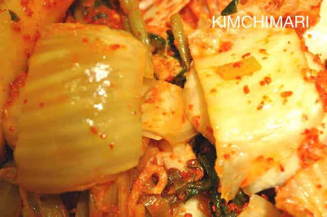 Sour kimchi is on the left and less ripe fresh kimchi on the right
