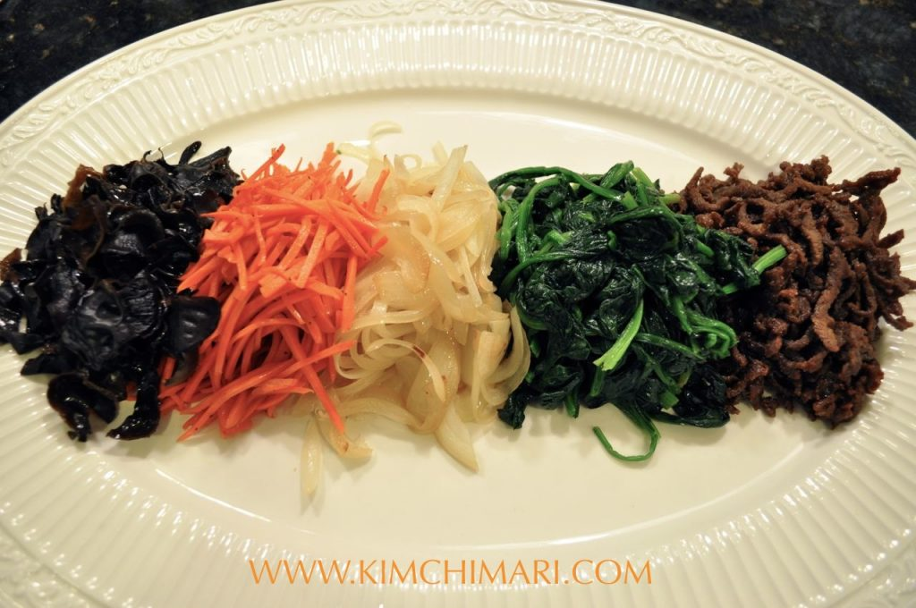 Japchae Ingredients all laid out (mushrooms, carrots, onions, spinach, beef)