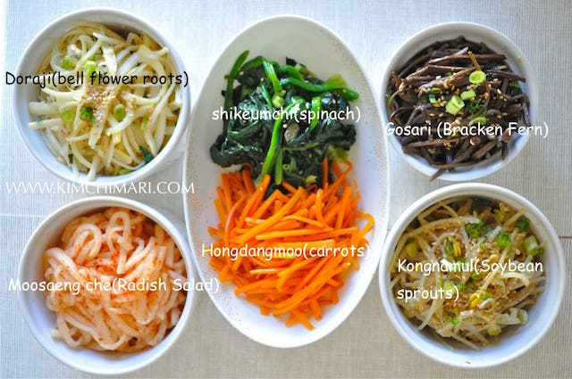 Bibimap vegetables in bowls - spinach, carrots, soybean sprouts, radish, bracken fern, bellflower roots
