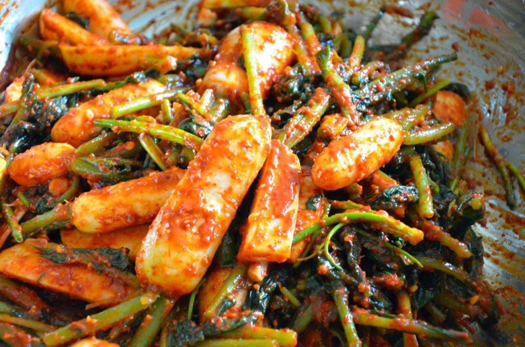 Young Radish Kimchi mixing in bowl