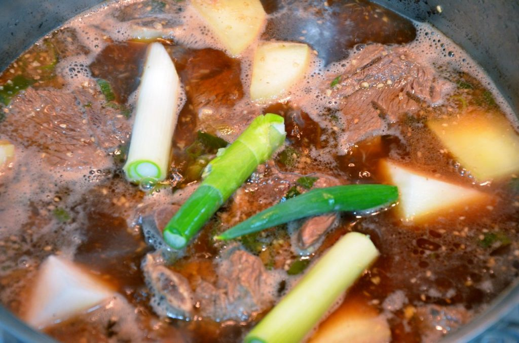 Galbi jjim boiling with green onions and radish