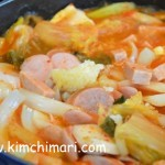 kimchi sausage spam onions boiling in pot