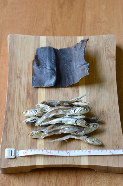 Dried Anchovies and Kelp for stock with a ruler on cutting board