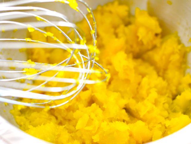 Mashing cooked squash for salad