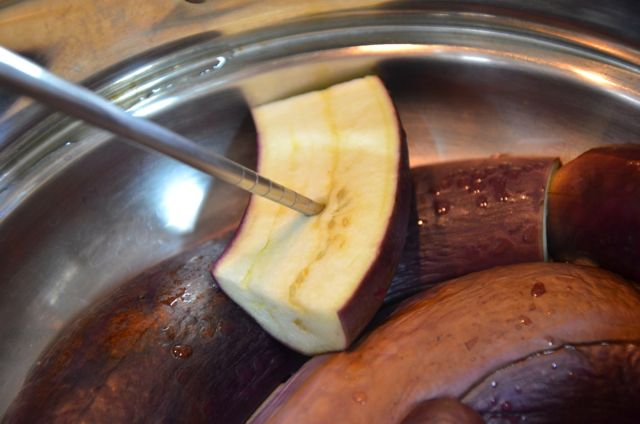 checking steamed eggplant to see if it's cooked