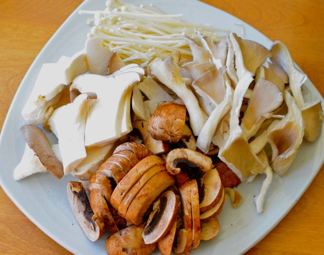 Enoki, Oyster, King Oyster, Brown mushrooms cut for Korean mushroom rice in Stone Pot