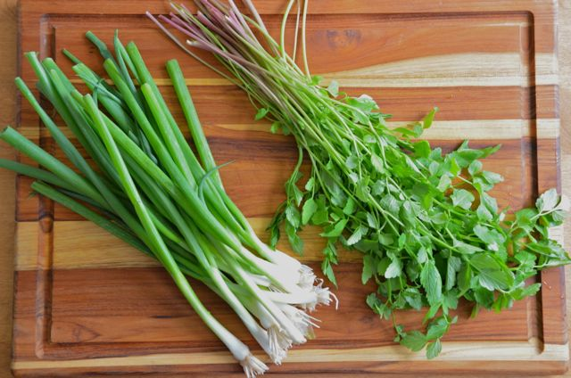 cleaned minari and green onions on cutting board