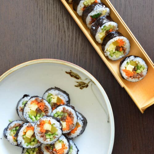 Kimbap Seaweed Rice Roll on plate on wood table