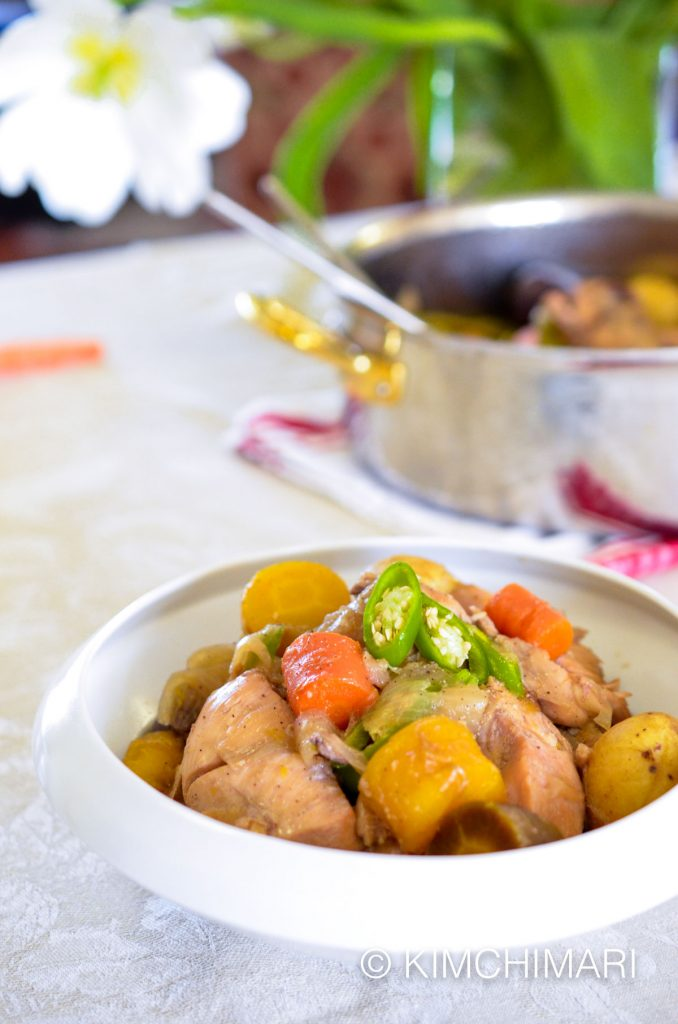 Dakdoritang with carrots, colored potatoes and green chili peppers