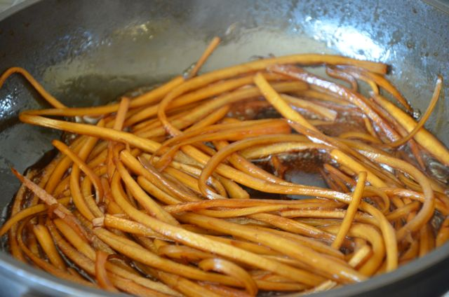 burdock braising in soy sauce in pan