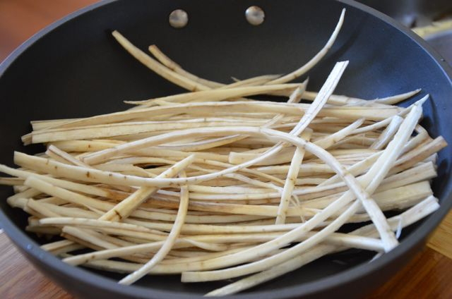 Burdock sticks in frying pan