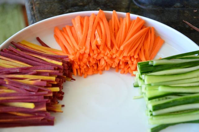 Orange and purple carrots and cucumber, julienned