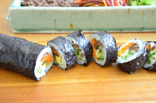 gimbap (kimbap) rolls slices laid out on board