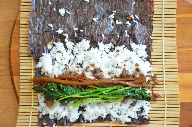 layer spinach and/or burdock root for kimbap