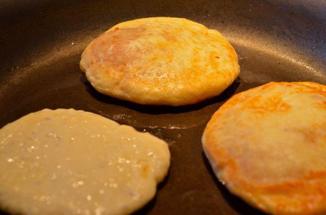 Hotteok (Korean Sweet pancake) frying in oil - www.kimchimari.com