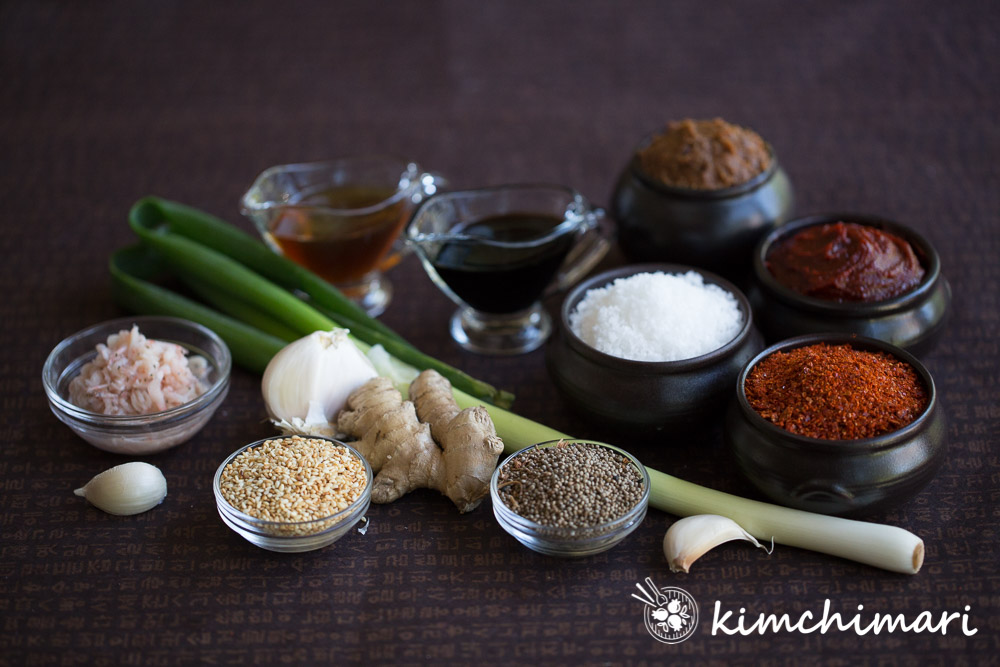 an array of korean cooking ingredients in bowls or just spread out on dark background