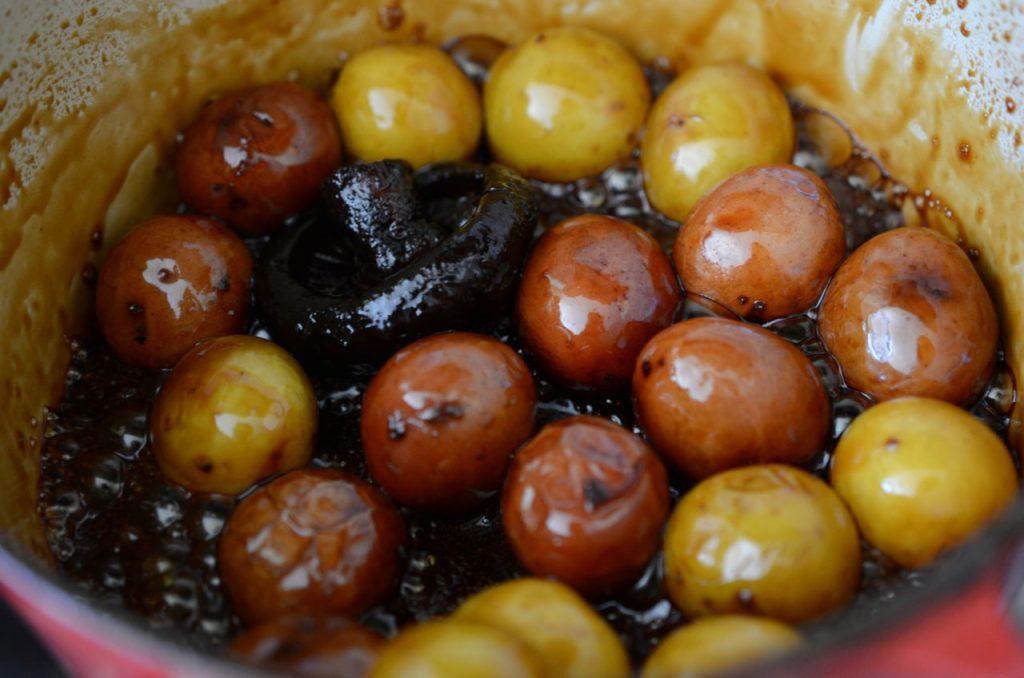 Korean potato side dish or gamja jorim almost done cooking
