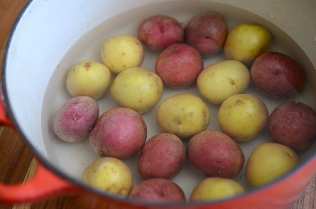 baby potatoes in pot with water