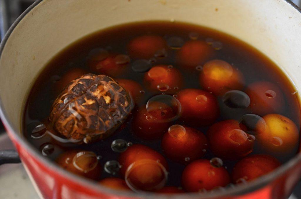 korean potato side dish (gamja jorim) cooking in pot