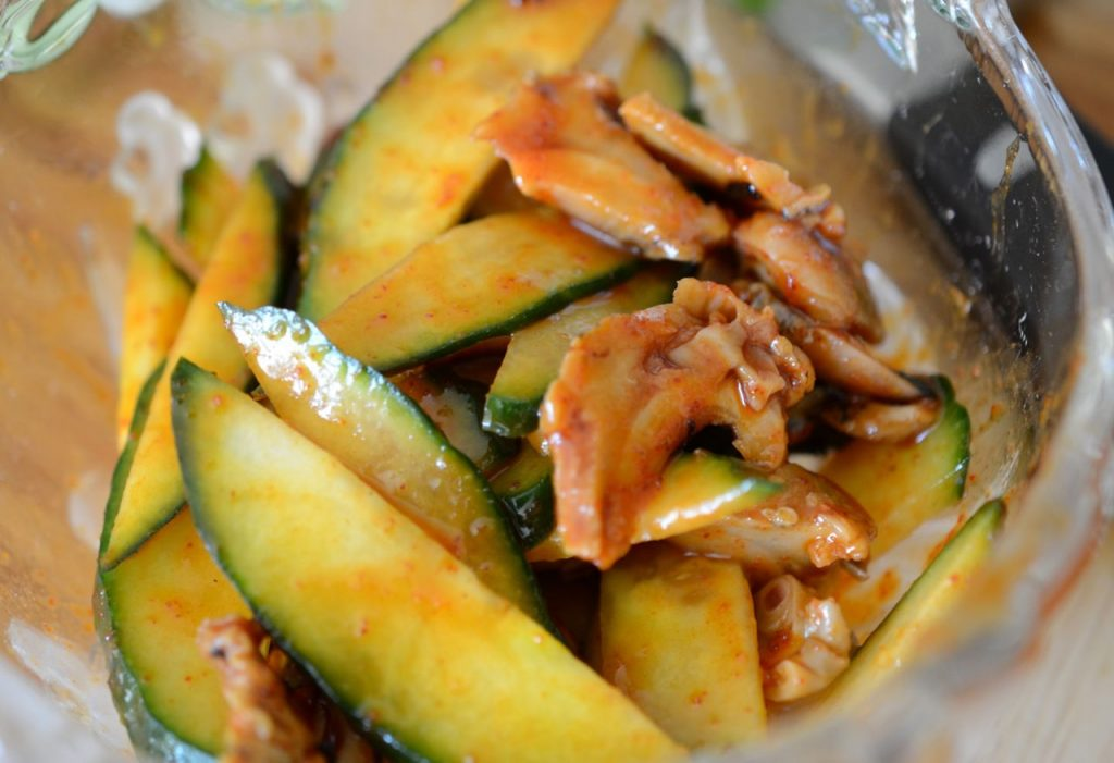 Cucumber and Sea snails tossed in Bibim Men Sauce