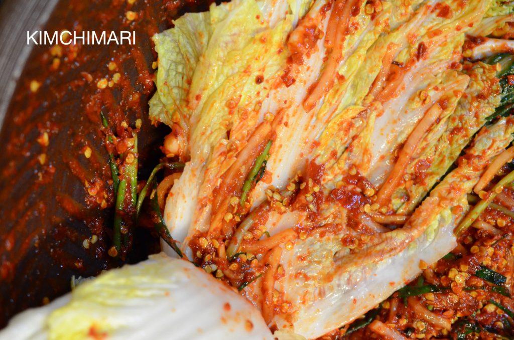 Stuffing cabbage Kimchi with kimchi yangnyeom (seasoning)