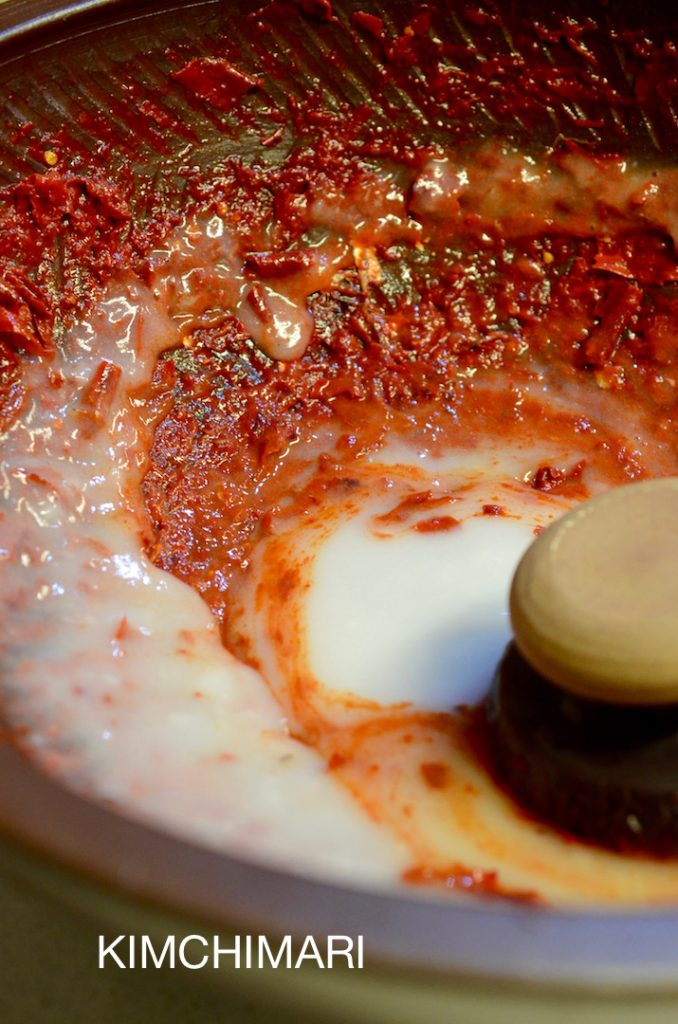 Mixing sweet rice paste with red chili pepper for Kimchi