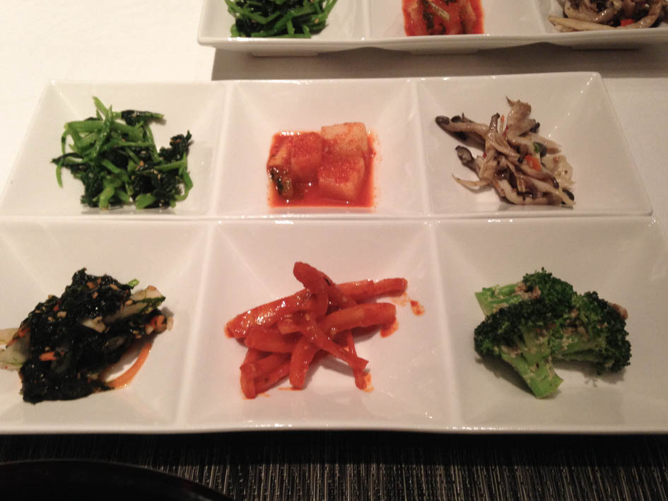 Left to Right, Top to bottom: Banchan (spinach, kkakduki, oyster mushrooms, seaweed salad, bellflower roots, broccoli)