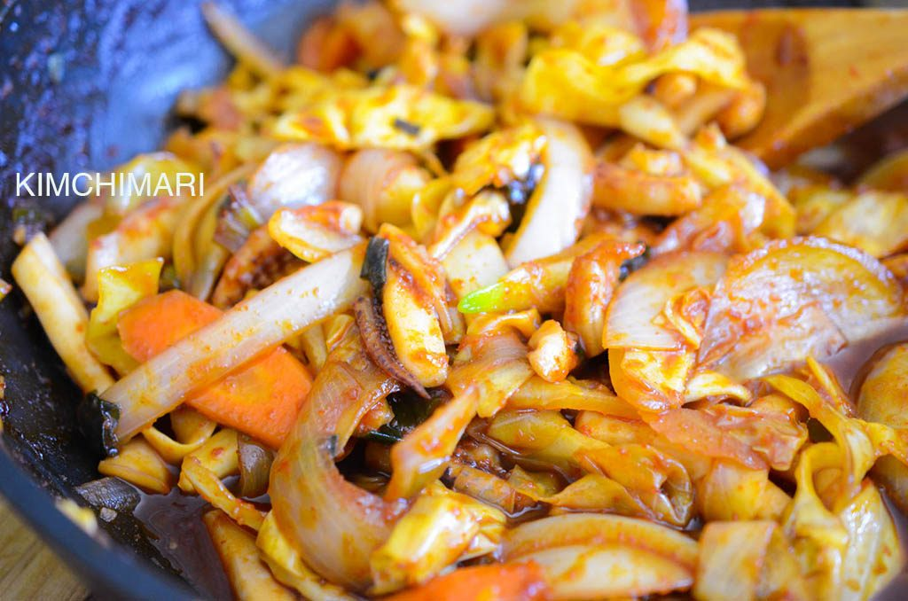 Spicy squid stir fry or Ojingeo Bokkeum cooking in pan