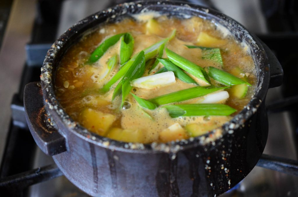 Doenjang Jjigae finished with green onions added