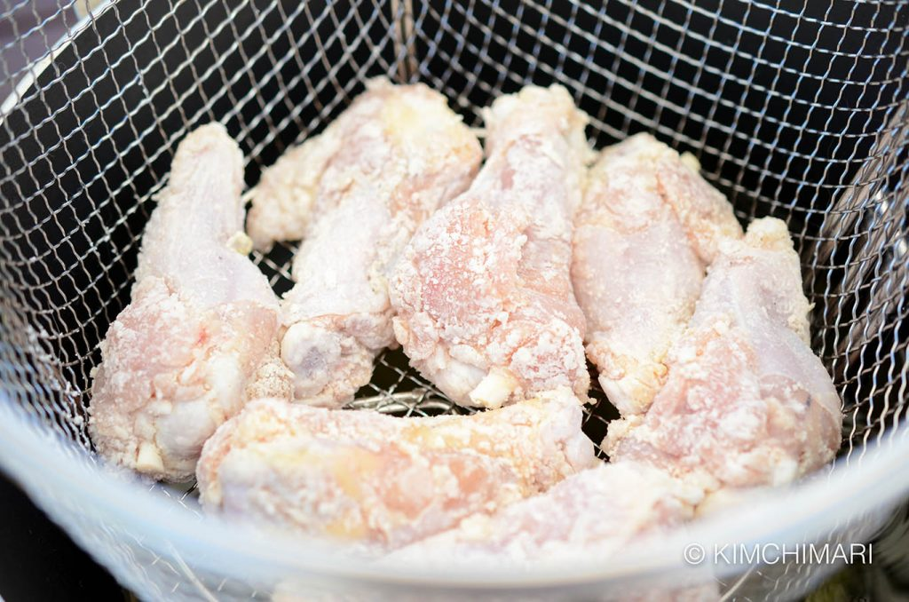 Chicken in basket for frying
