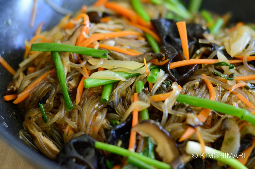 Korean glass noodles Japchae with green onions