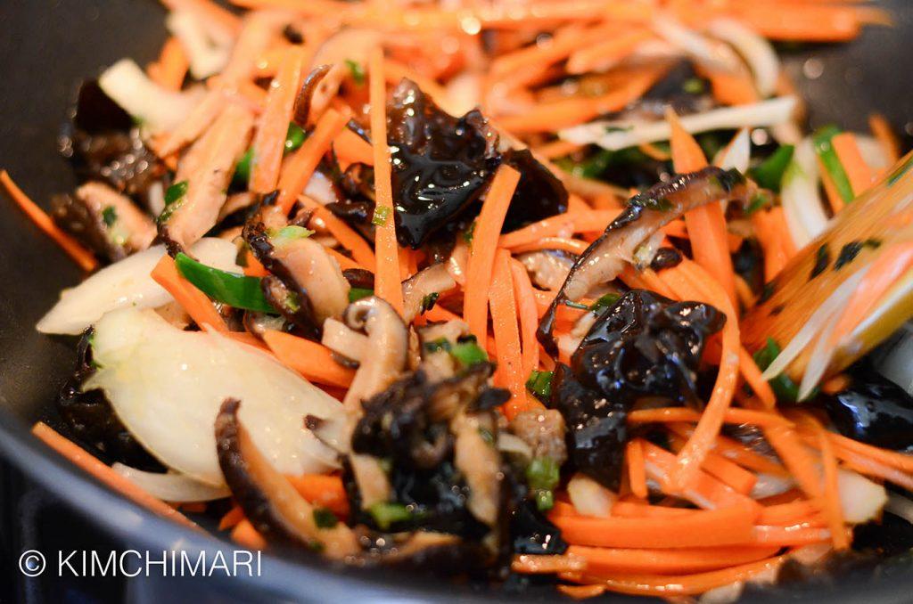 Stir-frying vegetables for Japchae
