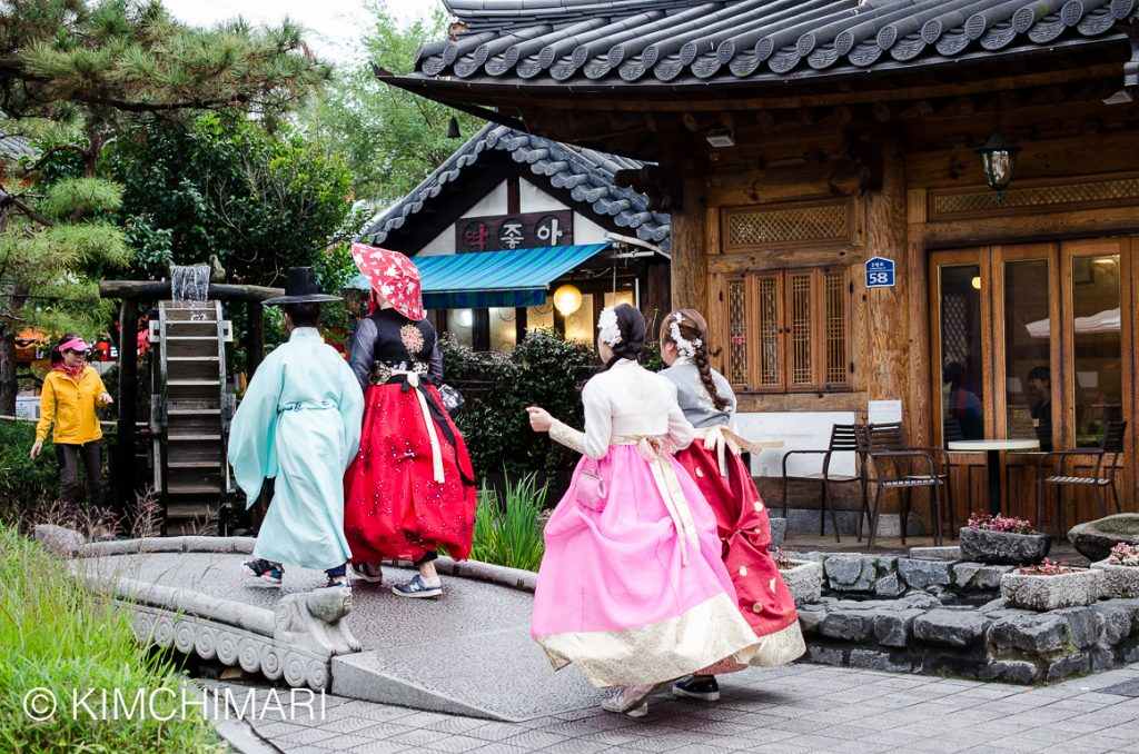 Hanbok dressed young ones walking around in Hanok Village, Jeonju