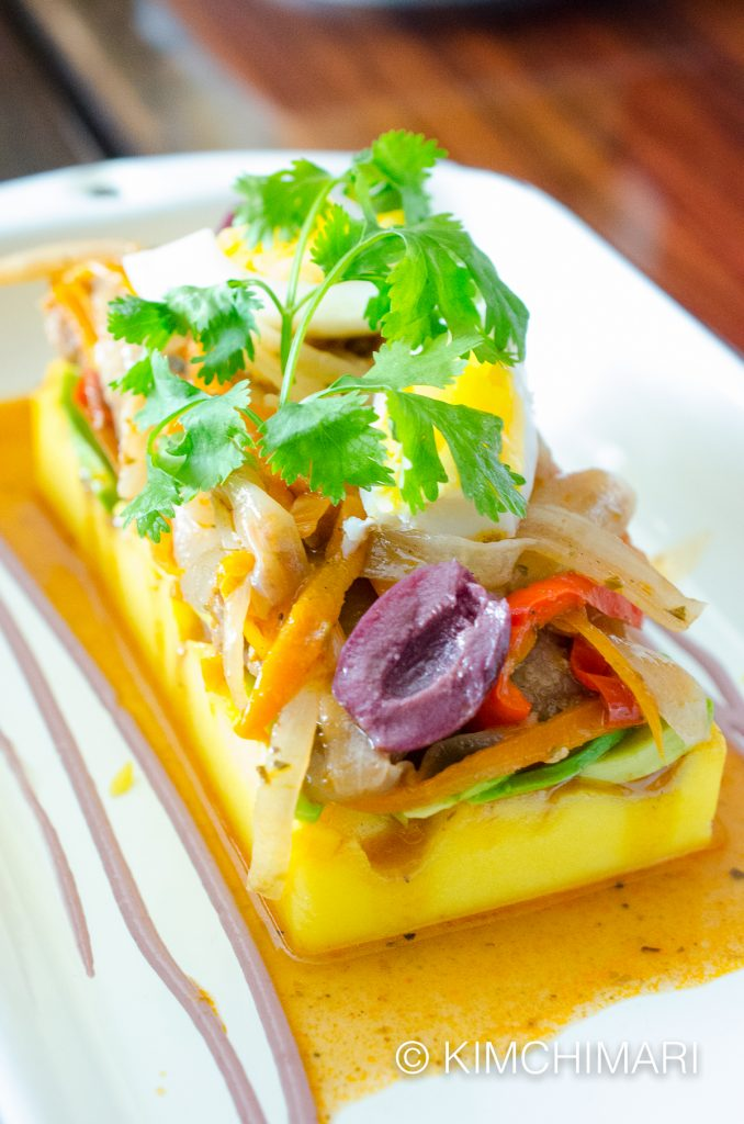 Causa De Bonito (Creamy Potato topped with avocado, fish and olives)