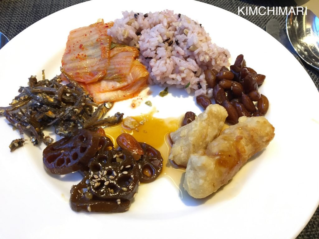 Korean breakfast with banchan (anchovies, lotus, peanuts, and kimchi