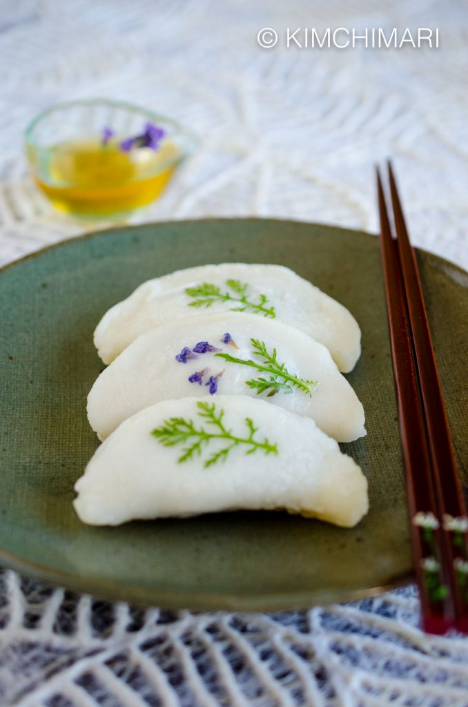 pan fried rice cake dumplings decorated with edible leaves served with honey