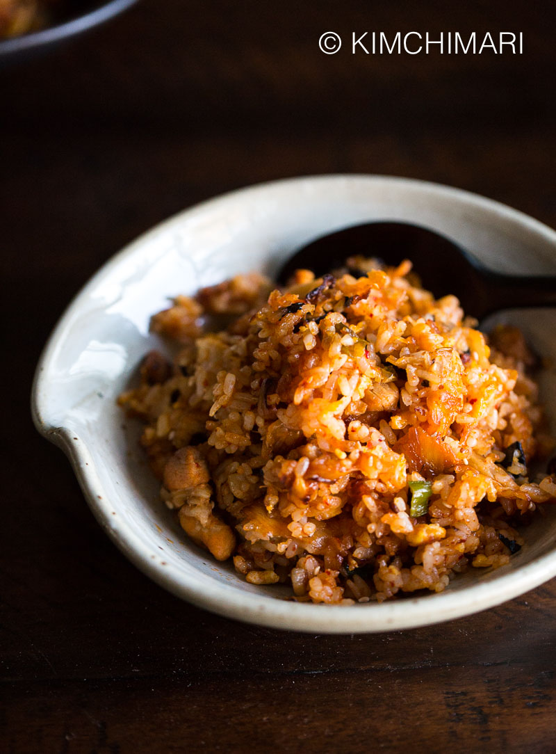Kimchi Fried Rice in white bowl with a spoon