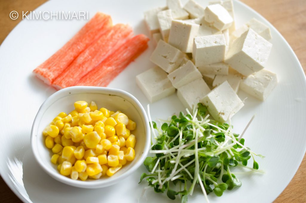 Tofu Salad ingredients - tofu, corn, imitation crab meat, daikon sprouts and iceberg lettuce (not in picture)